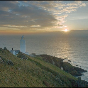 Sun rising above clouds at Start Point