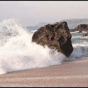 Wave breaking against isolated rock