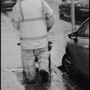 Sweeping the wet streets