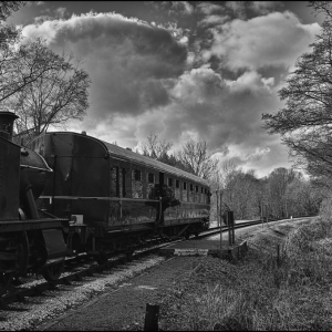 Passenger boarding the train at Nappers Halt, a request stop